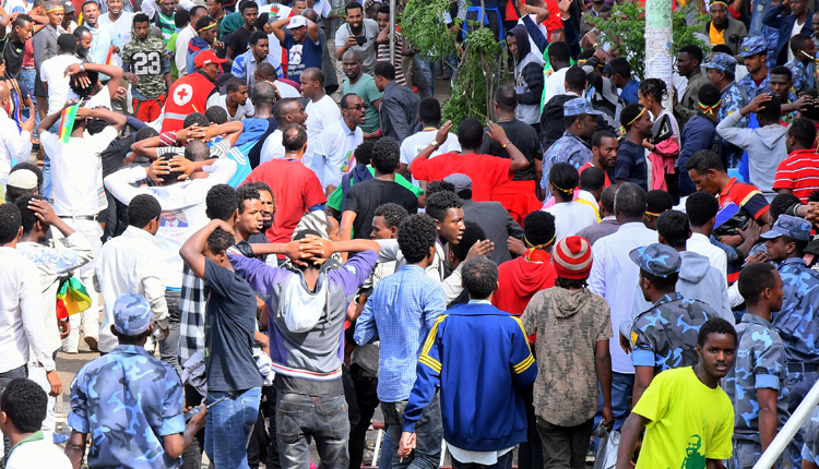 Ethiopians react after a blast during a rally in support of the new Prime Minister Abiy Ahmed in Addis Ababa, Ethiopia June 23, 2018. Stringer