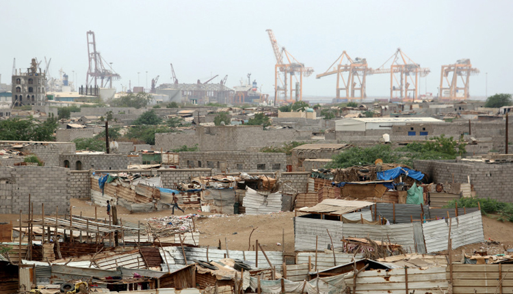 Hodeidah port's cranes are pictured from a nearby shantytown in Hodeidah, Yemen. (photo credit: (Reuters/Abduljabbar Zeyad)
