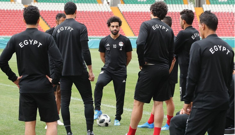 Mohamed Salah talks to his teammates during a workout in Grozny, Russia on Sunday. (Karim Jaafar/Agence France-Presse/Getty Images)