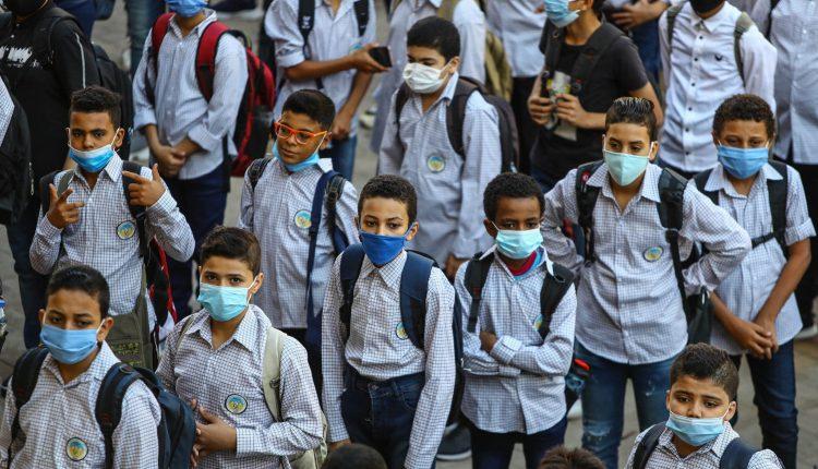 Egyptian students wearing masks